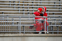 Adam Freed and his son Lex, 8, of Grove City watch the second half of Ohio State's game against Oregon on the big screen prior to the celebration for winning the national championship at Ohio Stadium on Jan. 24, 2015. (Adam Cairns / The Columbus Dispatch)
