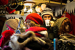 © Joel Goodman - 07973 332324 . 21 November 2013 . Manchester , UK . Hat stall . Candid photos of the Christmas Markets in Manchester City Centre . Photo credit : Joel Goodman