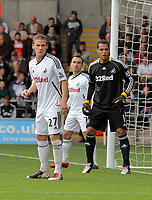 Pictured: (L-R) Mark Gower, Leon Britton and Michel Vorm of Swansea City. Saturday 17 September 2011<br /> Re: Premiership football Swansea City FC v West Bromwich Albion at the Liberty Stadium, south Wales.