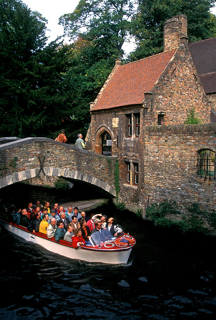 People, boat ride along canal, city of Brugge, West Flanders Province, Belgium, Europe