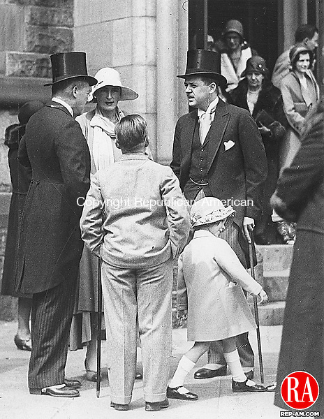 April 5, 1931 - WATERBURY - Mr. and Mrs. Rodney Chase talk with fellow parishioners after Easter Sunday mass at St. John's Church. Republican-American Archives