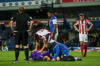 Stoke City U23s' goalkeeper Jakob Haugaard is treated on the pitch before being stretchered off after a collision making an attempted save from which Blackburn Rovers scored their opening goal<br /> <br /> Photographer Andrew Kearns/CameraSport<br /> <br /> The EFL Checkatrade Trophy - Blackburn Rovers v Stoke City U23s - Tuesday 29th August 2017 - Ewood Park - Blackburn<br />  <br /> World Copyright &copy; 2018 CameraSport. All rights reserved. 43 Linden Ave. Countesthorpe. Leicester. England. LE8 5PG - Tel: +44 (0) 116 277 4147 - admin@camerasport.com - www.camerasport.com