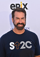 SANTA MONICA, CA. September 07, 2018: Rob Riggle at the 2018 Stand Up To Cancer fundraiser at Barker Hangar, Santa Monica Airport.SANTA MONICA, CA. September 07, 2018: Michael Ealy at the 2018 Stand Up To Cancer fundraiser at Barker Hangar, Santa Monica Airport.