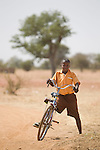 A schoolboy on his bicycle near the town of Bolgatanga in northern Ghana..Ghana 20 January 2012.