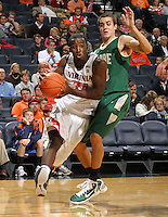 Nov. 12, 2010; Charlottesville, VA, USA; Virginia Cavaliers guard K.T. Harrell (24) drives past William & Mary Tribe forward JohnMark Ludwick (33) during the game at the John Paul Jones Arena. Virginia won 76-52.  Mandatory Credit: Andrew Shurtleff