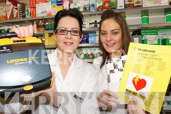 HEALTH ISSUES: Glin pharmasist Anna McCartan and Sarah White with the defibrillator which will be used as part of a local initiative to train people to use the life saving apparatus.
