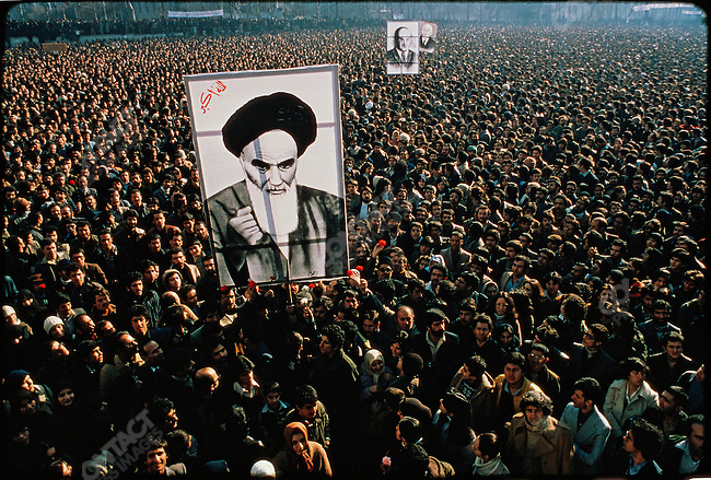 Anti-Shah demonstrators at Tehran University with large size hand-painted canvasses of the Ayatollah Khomeini and the late prime minister Mohammed Mossadegh. January 13, 1979.