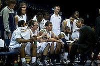The MSU Bobcats basketball team gets coaching instructions from head coach Huse