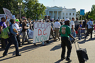 "October 6, 2011  (Washington, DC)  Protesters march past the White House.  Hundreds of people from around the country descended on Washington for ""Occupy DC"", a movement that has spread from New York City's ""Occupy Wall Street""    (Photo by Don Baxter/Media Images International)"