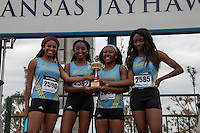 The Grandview girls 4x100 relay squad pose with their trophy after winning the event at the 2015 Kansas Relays.