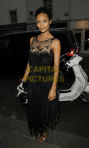 "THANDIE NEWTON.The ""Martini: Stay Beautiful"" launch party, Tini Bar, Walton St., London, England..June 9th, 2009.full length black dress lace layers layered clutch bag sleeveless.CAP/CAN.©Can Nguyen/Capital Pictures."
