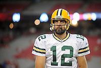 Aug. 28, 2009; Glendale, AZ, USA; Green Bay Packers quarterback (12) Aaron Rodgers against the Arizona Cardinals during a preseason game at University of Phoenix Stadium. Mandatory Credit: Mark J. Rebilas-