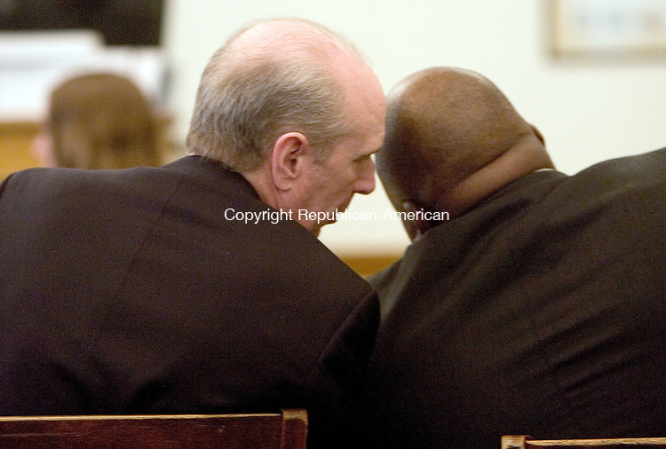 LITCHFIELD, CT. 10 January 2012-011012SV04-Kevin Campbell leans over and talks to one of his attorneys, Damian Tucker, right, while listening to testimony during his trial in Superior Court in Litchfield Tuesday. Campbell is on trial for allegedly murdering Roland Lagasse in a dispute over membership in the Forbidden Motorcycle Club in Torrington. The incident took place in 2008. .Steven Valenti Republican-American