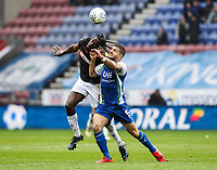 Bolton Wanderers' Clayton Donaldson competing with Wigan Athletic's Sam Morsy <br /> <br /> Photographer Andrew Kearns/CameraSport<br /> <br /> The EFL Sky Bet Championship - Wigan Athletic v Bolton Wanderers - Saturday 16th March 2019 - DW Stadium - Wigan<br /> <br /> World Copyright &copy; 2019 CameraSport. All rights reserved. 43 Linden Ave. Countesthorpe. Leicester. England. LE8 5PG - Tel: +44 (0) 116 277 4147 - admin@camerasport.com - www.camerasport.com