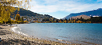 A panoramic photo of Queenstown Bay and Lake Wakatipu in Autumn. Queenstown is know as one of the most visited tourist destinations on New Zealand's South Island thanks to its wealth of adventure activities, many of which revolve around Lake Wakatipu.