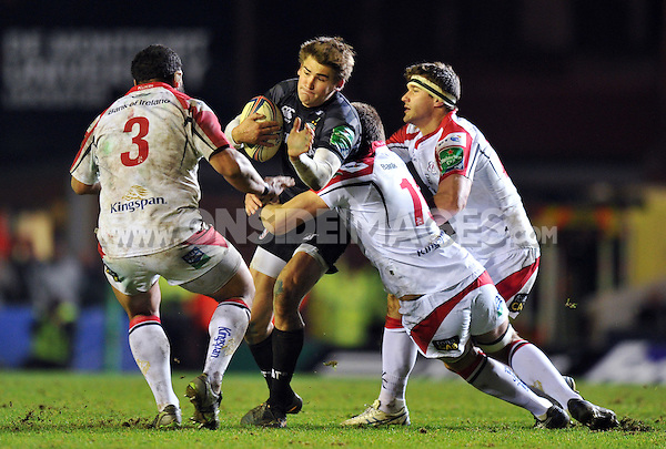 Toby Flood takes on the Ulster defence. Heineken Cup match, between Leicester Tigers and Ulster Rugby on January 18, 2014 at Welford Road in Leicester, England. Photo by: Patrick Khachfe / JMP