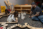 TORRINGTON, CT - 31 DECEMBER 2019 - 123119JW02.jpg --  Paul Valenti oversees the construction work done by daughters Rebecca and Olivia Valenti during the New Years Eve celebration at KidsPlay Children's Museum Tuesday morning. Jonathan Wilcox Republican-American