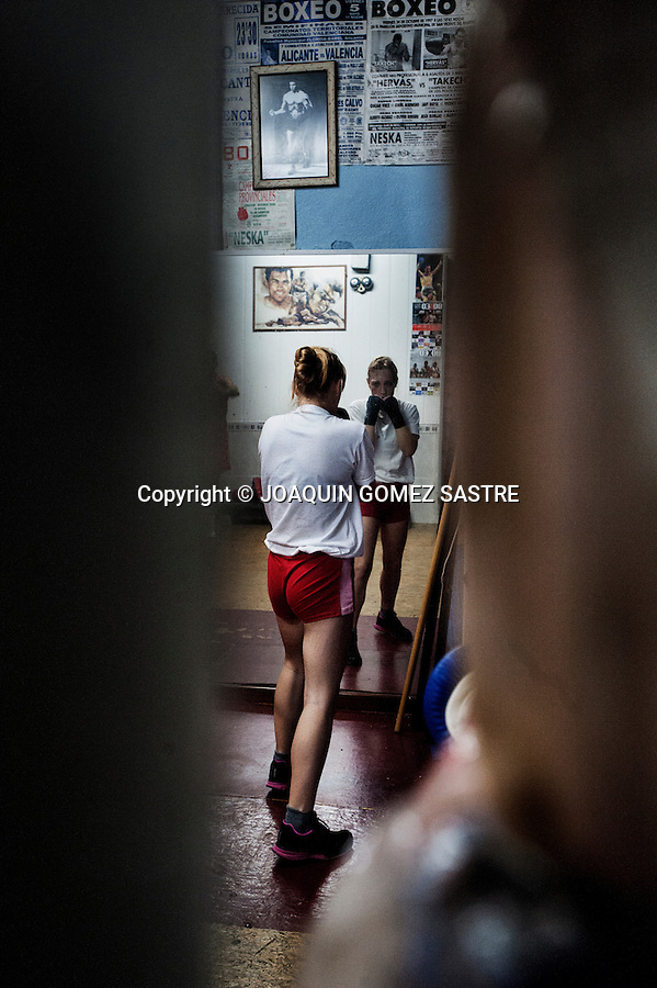 Reflection of young amateur boxer Mary in one of the mirrors Martinez Boxing Club