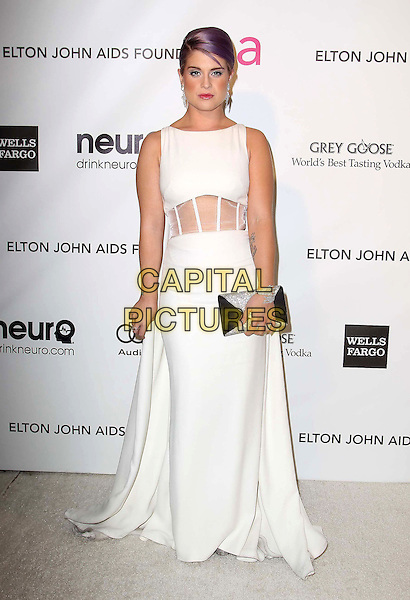 Kelly Osbourne.The 21st Annual Elton John AIDS Foundation Academy Awards Viewing Party held at The City of West Hollywood Park in West Hollywood, California, USA..February 24th, 2013.oscars full length white sleeveless dress  sheer cape tattoos cut out panel waist black clutch bag dyed purple hair.CAP/ADM/KB.©Kevan Brooks/AdMedia/Capital Pictures.