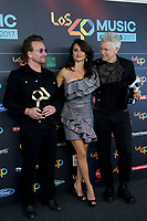 MADRID, SPAIN - NOVEMBER 10:  Bono, Penelope Cruz and Adam Clayton attend the 40 Music Awards press room at WiZink Center on November 10, 2017 in Madrid, Spain.  ***NO SPAIN***<br /> CAP/MPI/RJO<br /> &copy;RJO/MPI/Capital Pictures