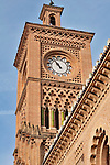 The clock tower of the train station in Toledo, Spain