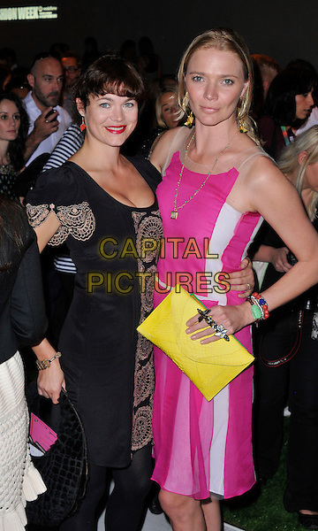 Jasmine Guinness and Jodie Kidd .at the Jasper Conran show at London Fashion Week LFW, London, England, UK, 15th September 2012..half length black lace beige dress pink yellow clutch bag  arm around .CAP/WIZ.© Wizard/Capital Pictures.