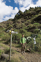 Spain, Canary Islands, La Palma, near Los Llanos de Aridane: Barranco de las Angustias - man hiking towards Caldera de Taburiente