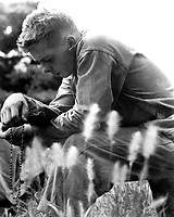 A young Marine finds a moment of quiet and solitude in which to offer up a prayer for the safety of himself and his comrades.  Minutes later, the 1st Marine Division launched an offensive against entrenched communist troops.  Ca. 1951. Cpl. Eugene Suarez.  (Marine Corps)<br /> Exact Date Shot Unknown<br /> NARA FILE #  127-N-A156900<br /> WAR &amp; CONFLICT BOOK #:  1462