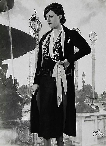 d'Ora Paris. Afternoon ensemble of black crepe. Model Nina Ricci (50703). About 1937. Photograph.