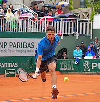 Paris, France, 22 june, 2016, Tennis, Roland Garros, Robin Haase (NED) volleys in while it rains<br /> Photo: Henk Koster/tennisimages.com