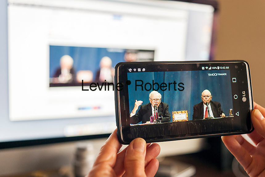 For the first time the annual shareholder meeting of Berkshire Hathaway, from Omaha, Nebraska, is being live streamed on Yahoo! Finance on Saturday, April 30, 2016. Warren Buffett, left, the Oracle of Omaha,  and his right-hand man Charlie Munger, right, answer questions at the meeting.  (© Richard B. Levine)