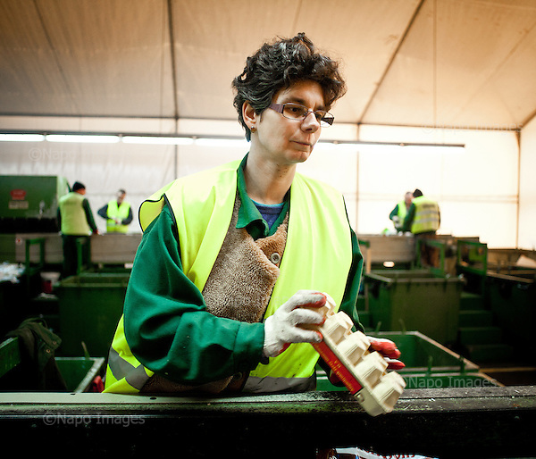 Warsaw, Poland, November 2011:.Iza, employee of Ekon Association, during work at the recycling facility. .Ekon Association in Warsaw is a recycling plant that provides jobs for people with learning difficulties or mental health issues; who would otherwise find it difficult to get work. .(Photo by Piotr Malecki / Napo Images)..Warszawa, Listopad 2011:.Iza, pracowniczka stowarzyszenia Ekon, podczas pracy w sortowni odpadow..Ekon zajmuje sie recyklingiem odpadow i zatrudnia ludzi uposledzonych, lub chorych psychicznie, ktorzy inaczej mieliby trudnosci ze znalezieniem pracy..Fot: Piotr Malecki / Napo Images.