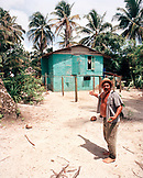PANAMA, Bocas del Toro, a local man in front of his home by the Caribbean Sea, Central America