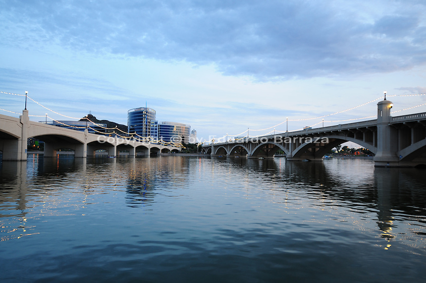 Tempe, Arizona. A south view of Tempe Town Lake at sunset shows the Mill Avenue bridges. Photo by Eduardo Barraza © 2015