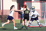 Santa Barbara, CA 02/18/12 - Amy Corstorphine (UC Davis #32), Samantha Fannin (UC Davis #22) and Hayley Bernstein (Colorado State #15) in action during the UC Davis - Colorado State game at the 2012 Santa Barbara Shootout.  Colorado State defeated UC Davis 10-9.