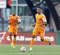 Houston Dynamo forward Giles Barnes (23) brings the ball forward.  In a Major League Soccer (MLS) match, the New England Revolution (blue/white) defeated Houston Dynamo (orange), 2-0, at Gillette Stadium on April 12, 2014.