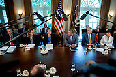 United States President Barack Obama, center, speaks during a cabinet meeting at the White House with Arne Duncan, U.S. education secretary, from left, Sylvia Mathews Burwell, secretary of the U.S. Department of Health and Human Services (HHS), Sally Jewell, U.S. secretary of the interior secretary, Obama, Chuck Hagel, U.S. secretary of defense, and Penny Pritzker, U.S. secretary of commerce, in Washington, D.C., U.S., on Tuesday, July 1, 2014. Obama said yesterday he'll go it alone on changing U.S. immigration rules because House Republicans won't act. <br /> Credit: Andrew Harrer / Pool via CNP