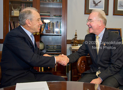 United States Senator Chuck Grassley (Republican of Iowa) shakes hands with US Representative Tom Price (Republican of Georgia), US President-elect Donald J. Trump's selection to be US Secretary of Health and Human Services (HHS), in his Capitol Hill office in Washington, DC on Thursday, December 8, 2016.<br /> Credit: Ron Sachs / CNP
