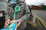 Burscough 3, Gillingham 2, 05/11/2005. Victoria Park, Burscough, FA Cup first round. A programme seller in the street before the match. The team from the Northern Premier League Premier Division defeated their Football League Championship rivals by 3-2 with two goals in the last minute, watched by a crowd of 1927 spectators. Photo by Colin McPherson.
