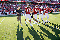 STANFORD, CA - SEPTEMBER 21: Honorary Captain Katie Ledecky walks out to participate in the coin toss with captains Colby Parkinson #84, Casey Toohill #52, Cameron Scarlett #22, and K.J. Costello #3 of the Stanford Cardinal during a game between University of Oregon and Stanford Football at Stanford Stadium on September 21, 2019 in Stanford, California.