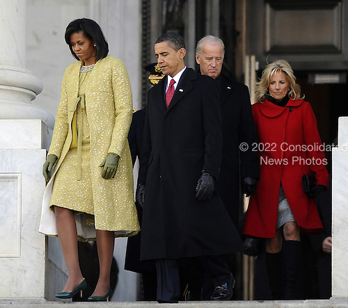 Washington, DC - January 20, 2009 -- United States President Barack Obama walks with his wife Michelle as they are followed by Vice president Joseph Biden and his wife Jill as they depart the U.S Capitol Building after Obama was sworn in as the 44th President of the United States during the 56th Presidential Inauguration ceremony in Washington, D.C., USA 20 January 2009..Credit: Tannen Maury - Pool via CNP