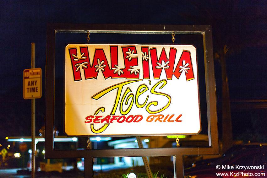 Haleiwa Joe's Seafood Grill Restaurant sign at night in Haleiwa, North Shore, Oahu, Hawaii