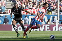Atletico de Madrid's Radamel Falcao (r) and Granada's Allan Romeo Nyom during La Liga match.April 14,2013. (ALTERPHOTOS/Acero)