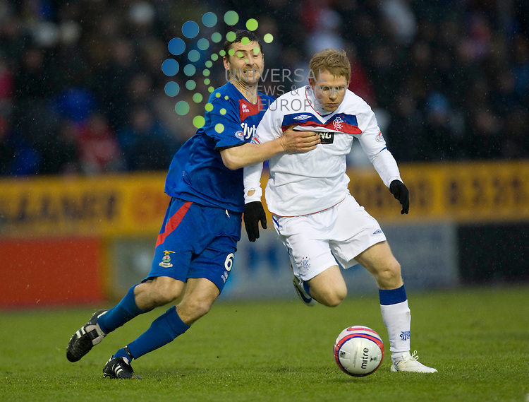 FOOTBALL.Scottish Premier League.Inverness CT v Rangers.Pictured is .Inverness player (red/blue) Roy McBain hold onto.Rangers player (white) Chris Burke