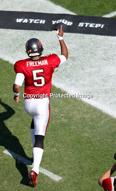 Tampa Bay Buccaneers quarterback Josh Freeman (5) enters the field prior to a game between the Houston Texans and the Buccaneers.  The Texans defeated the Buccaneers 37-9 in an NFL preseason game Sunday, November 13, 2011 in Tampa, Fla.  (AP Photo/Margaret Bowles)