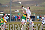 Dromids Tomás Curran gets the better of Skellig Rangers Aidan O'Sullivan in this aerial challenge with Dromids Declan O'Sullivan waiting for the breaking ball.