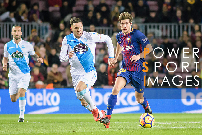 Jose Luis Mato Sanmartin of RC Deportivo La Coruna (L) in action against Sergi Roberto of FC Barcelona (R) during the La Liga 2017-18 match between FC Barcelona and Deportivo La Coruna at Camp Nou Stadium on 17 December 2017 in Barcelona, Spain. Photo by Vicens Gimenez / Power Sport Images