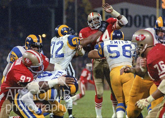 San Francisco 49ers vs. Los Angles Rams at Candlestick Park Monday, December 9, 1985..Rams beat the 49ers 27-20.San Francisco 49ers Defensive Tackle Gary Johnson (97) sacks Los Angles Rams Quarterback Jeff Kemp (9).