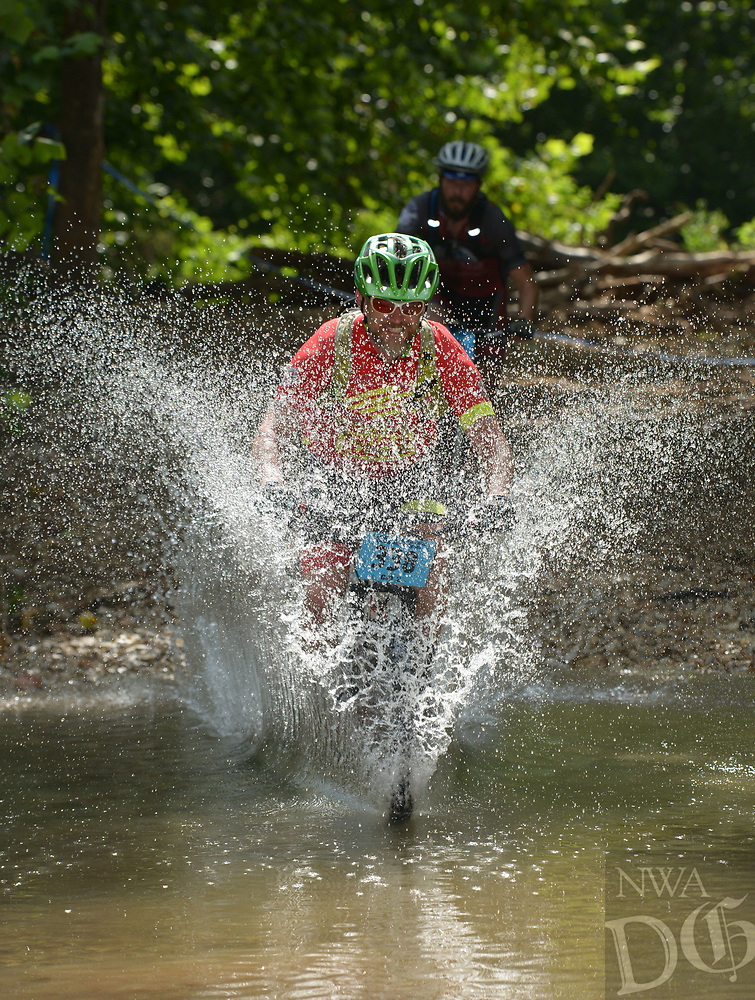 NWA Democrat-Gazette/BEN GOFF @NWABENGOFF<br /> Scott Moore, a category 2 men age 15-49 racer from Tulsa, Okla., fords a creek Sunday, July 16, 2017, during cross country races on the final day of the 19th annual Fat Tire Festival at Lake Leatherwood City Park in Eureka Springs.