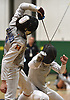 Michael DeSando of Ward Melville, left, battles Zachary Ortiz of Garden City in the Brentwood Holiday Tournament's boys foil final at Brentwood High School on Saturday, Dec. 15, 2018.